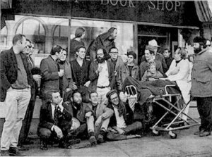 """Found on: http://madamepickwickartblog.com Outside City Lights Bookstore in San Francisco around 1970.  Levi Asher: """"The core group consisted of Jack Kerouac, Allen Ginsberg, Neal Cassady and William S. Burroughs, who met in the neighborhood surrounding Columbia University in uptown Manhattan in the mid-40's. They picked up Gregory Corso in Greenwich Village and found Herbert Huncke hanging around Times Square. They then migrated to San Francisco where they expanded their group consciousness by meeting Gary Snyder, Lawrence Ferlinghetti, Michael McClure, Philip Whalen and Lew Welch. Most of them struggled for years to get published, and it is inspiring to learn how they managed to keep each other from giving up hope when it seemed their writings would never be understood. Their moment of fame began with a legendary poetry reading at the Six Gallery in San Francisco."""""""